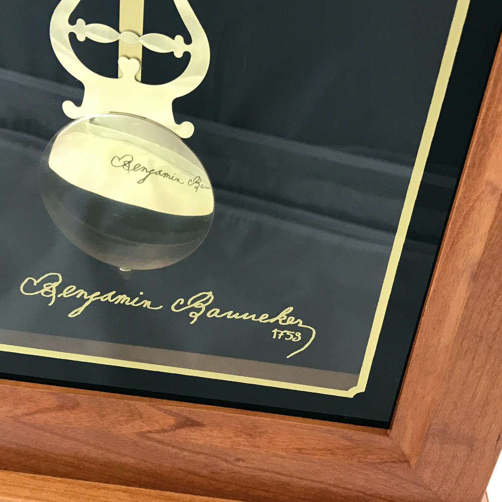 Gold Ink Replica Benjamin Banneker Signature is featured on the lower glass providing a unique view when it reflects on the solid brass pendulum.