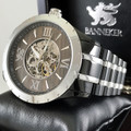 Fully Automatic XO Skeleton Movement.  Ionic Plated Stainless Steel.  Real Wood.  See through Case.    Experience 1753.