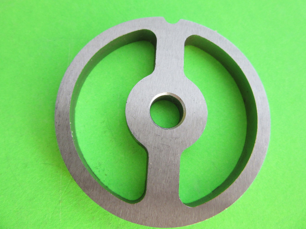 Size #5 2-hole sausage stuffer disc.  Use this disc when using your size #5 meat grinder to stuff sausage links.  You will not need the blade in the unit when using this part.
