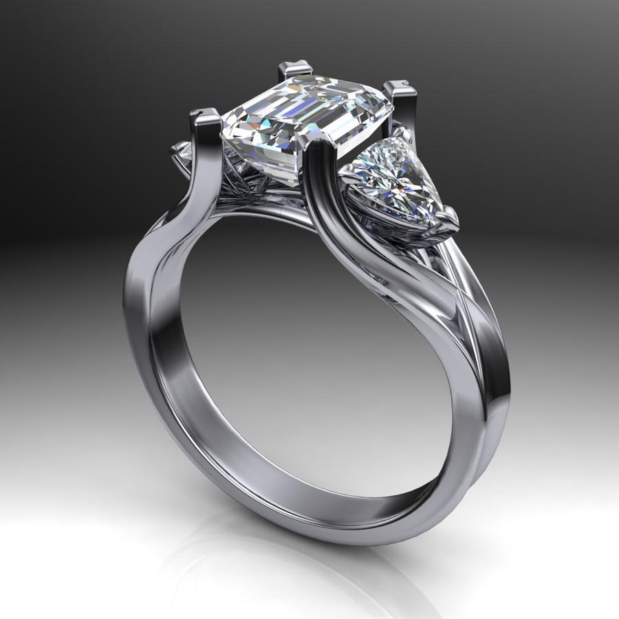 2 carat emerald cut diamond engagement ring dramatic