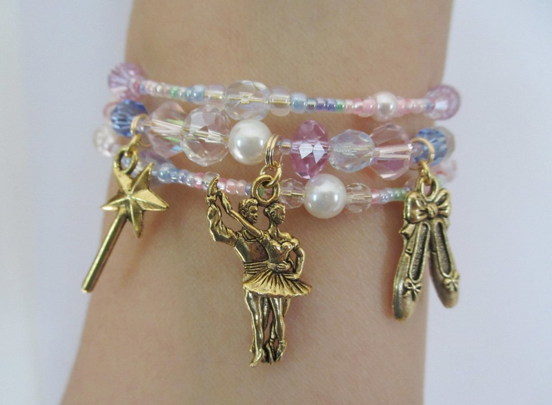 A wrist view of the Sugar Plum Fairy Bracelet- a perfect gift for fans of the famous opera the Nutcracker, evoking the unique beloved music of the Dance of the Sugar Plum Fairy.