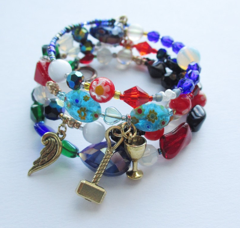 Colorful turquoise millefiore beads with a hammer and goblet charm evoke the gypsy chorus.