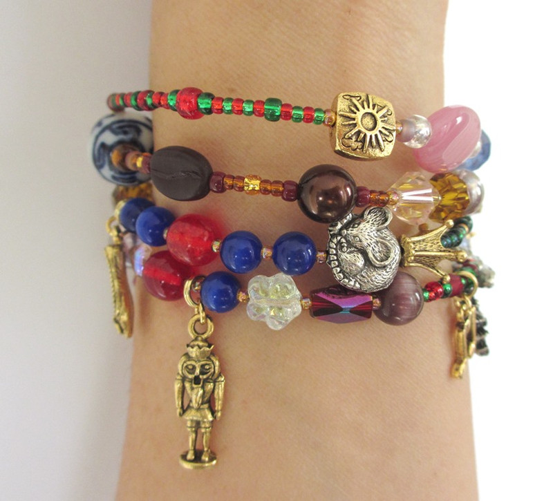 A detail view of the Mouse King beads and Nutcracker charm.