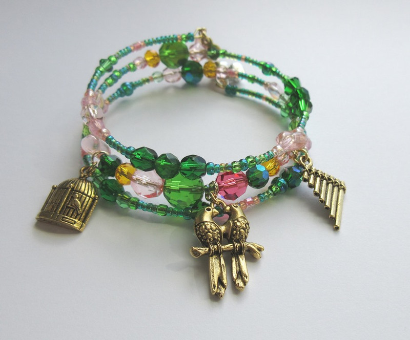 Charms include: Papageno's birdcage; his pan pipes and love birds indicating his destiny with Papagena.
