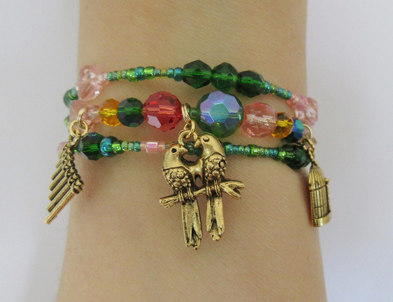 Beads inspired by the colors of love birds evoke the beloved bird catcher, Papageno.