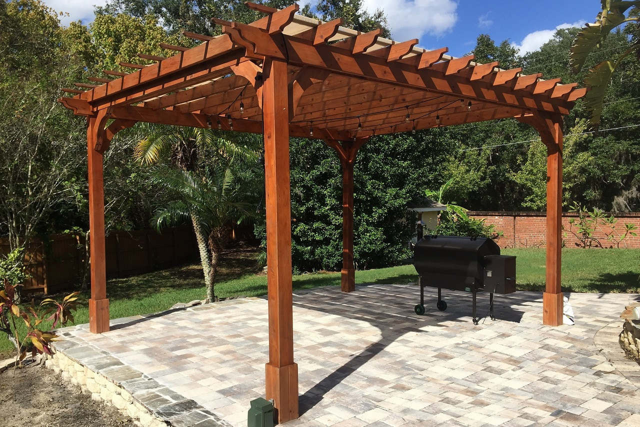 14' x 12' post-to-post Classic Red Cedar Pergola / 9 ft. minimum head clearance all sides / Main rafter supports (lowest beams) on the 14' side / Rafters run the 12' post to post / Winter Springs, Fl.