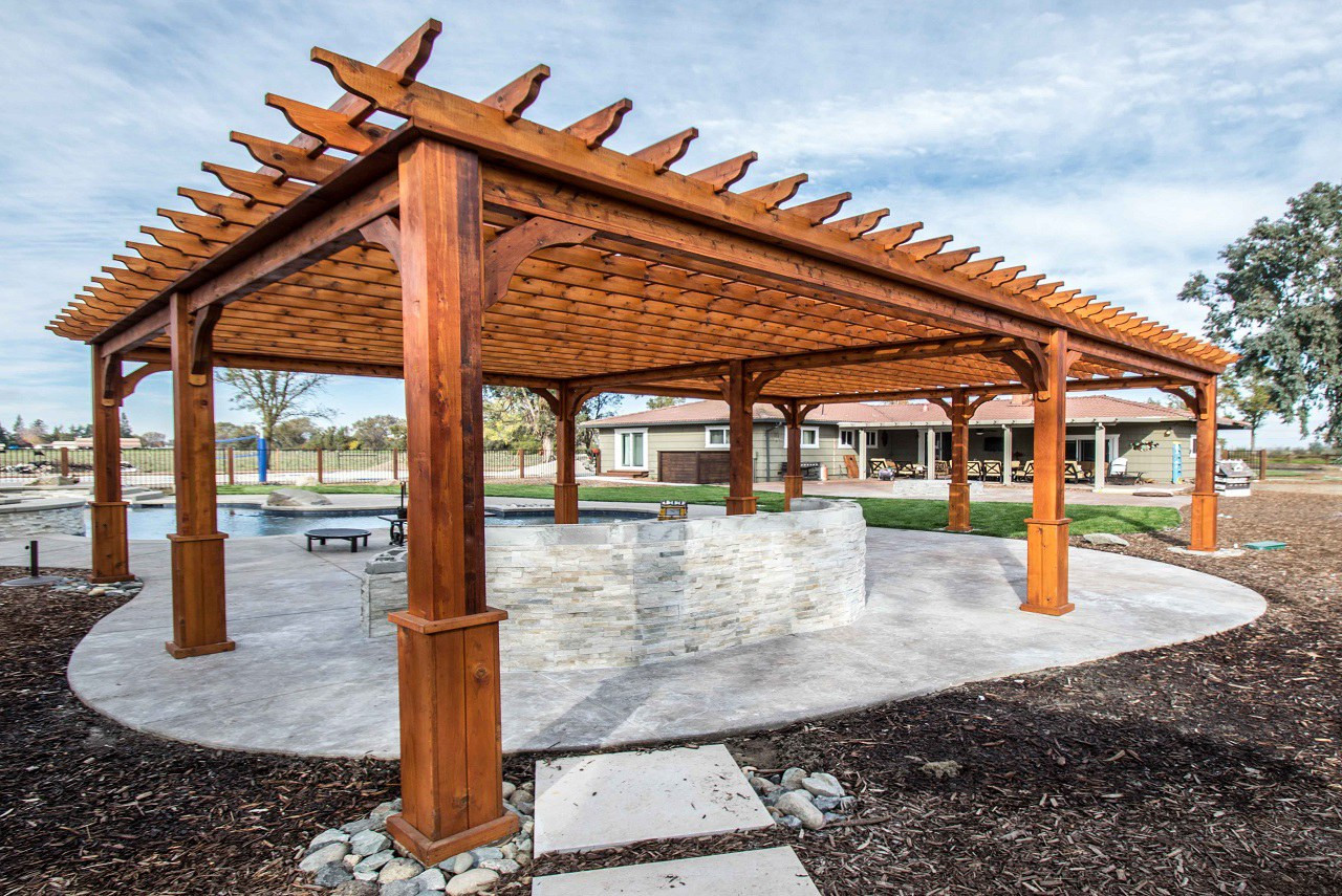 """32' x 22' post to post (outside of posts), 34' x 24' roof span / 8"""" sq. posts, 12' high / 2x6 top runners 12"""" apart on center running 32' / nine posts / standard anchors / Western Red Cedar / Elk Grove, CA."""