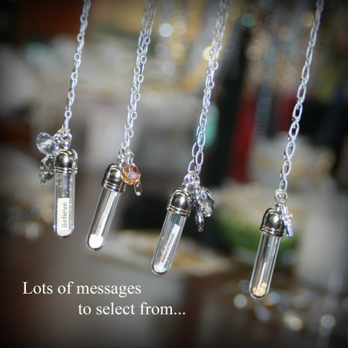 """We hand make each necklace with attention to detail in placing the """"message"""" in each bottle and adding charms and a bit of """"fairy dust"""" inside to add a bit of elegant sparkle. We have had a very excited reaction from our customers about these necklaces. Each is on a 24"""" chain."""
