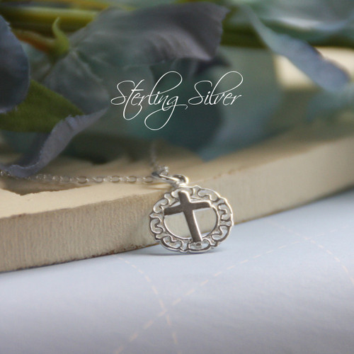STG-53  Sterling Silver Cross in Circle of Lace