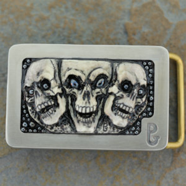 Belt Buckle with American Moose stag carving of 3 skulls with hematite eyes by Paul Grussenmeyer. Well highlighted and mounted in Paul's signature series stainless steel belt buckle.