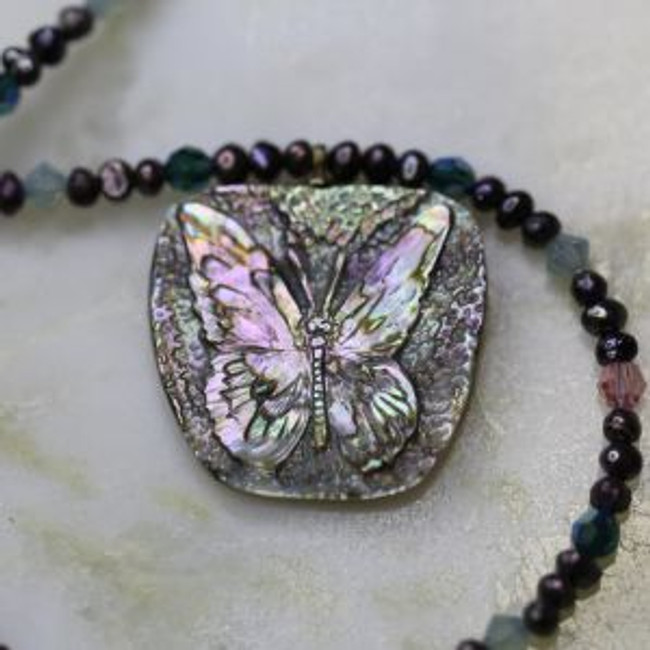 """Abalone butterfly carved by Paul Grussenmeyer, hung on a 17.75"""" necklace of seed pearls and Swarovski crystals, with 14kt gold toggle clasp"""