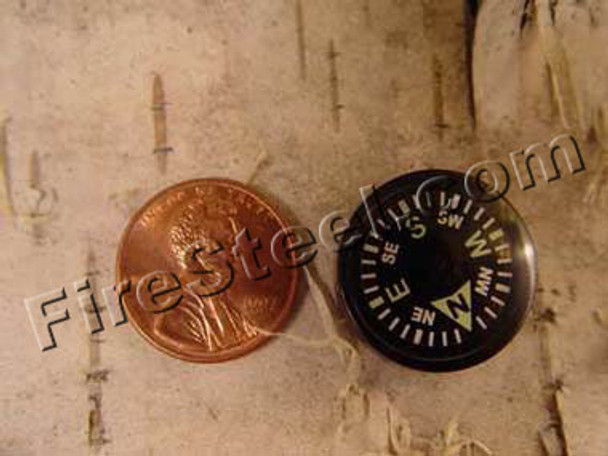 20-mm liquid filled button compass compared to a US penny.  I sprinkle these compasses amongst my gear and clothing to be sure I can always find the direction back to my vehicle or trail head.