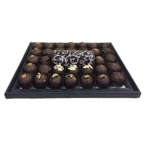 "Chocolate Platter with an assortment of Chocolate Truffles and a 5"" Chocolate Log."
