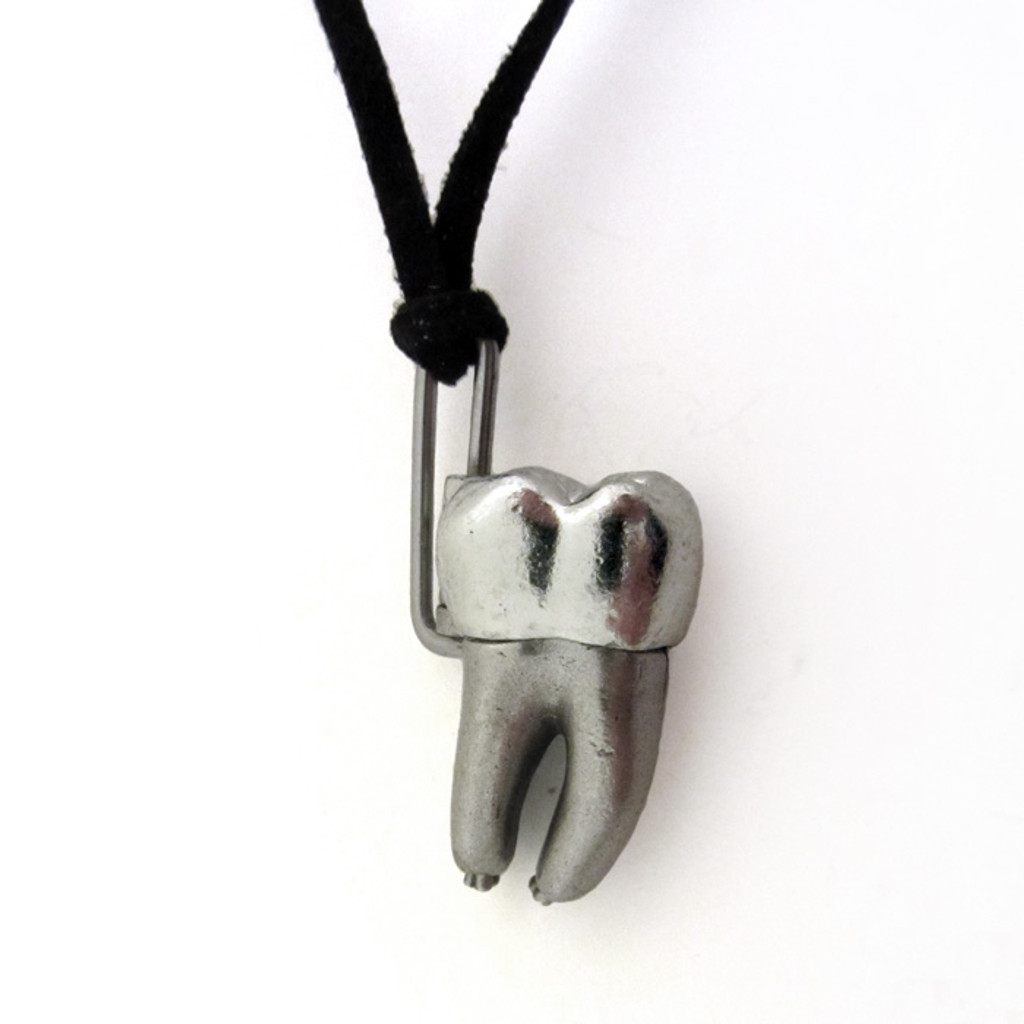 human tooth anatomy locket necklace in closed position