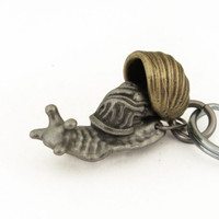 anatomical snail keychain with shell in open position