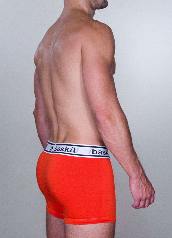 Baskit Light Trunk in blood orange color side.