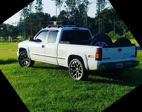 "Happy customer of ours with these 22"" black and machine snowflake rims on his truck with A/T tires"