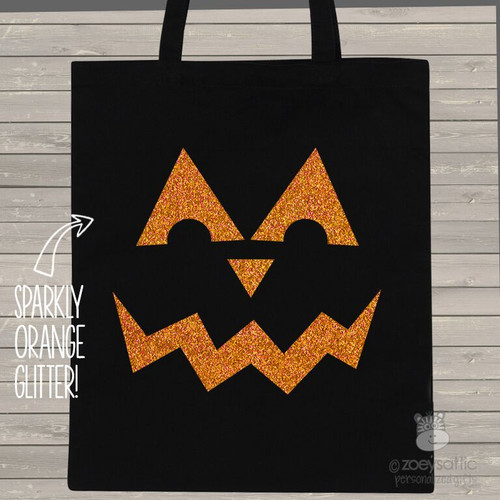 Halloween sparkly pumpkin face trick or treat bag