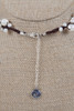 White Pearl Necklace on Dark Wax Cotton