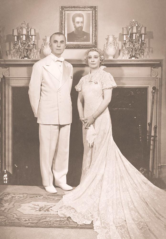 Mr & Mrs Ballard by the Fireplace