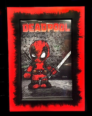 "Frankie Serna Collection; ""Baby Deadpool""  Displayed in 11x17  Black on Red Splatter Toploader Frame"