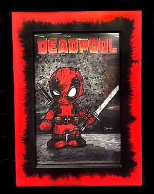"""Frankie Serna Collection; """"Baby Deadpool""""  Displayed in 11x17  Black on Red Splatter Toploader Frame"""