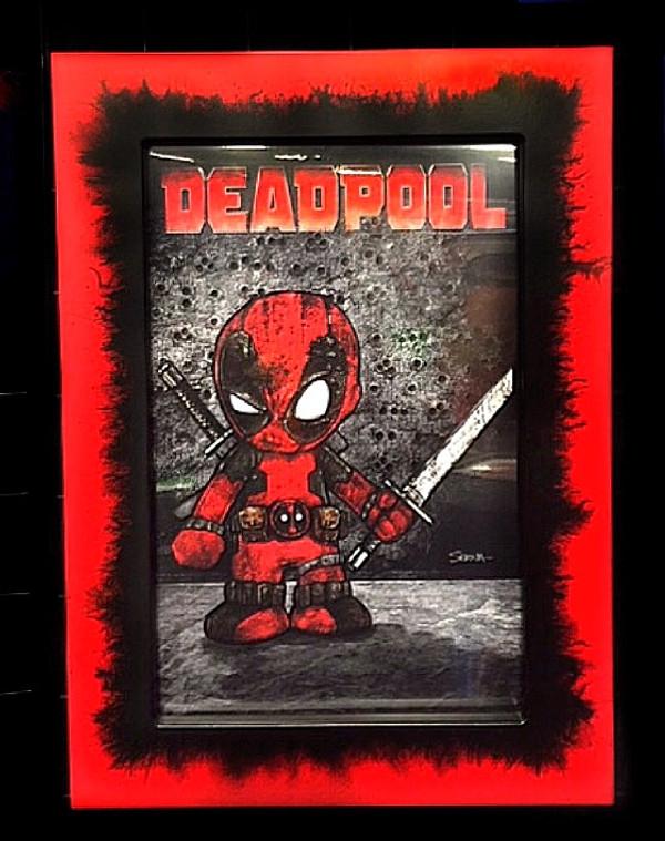 """Frankie Serna Collection; """"Baby Deadpool""""  Displayed in 11x17  Red/Black Splatter Toploader Frame"""