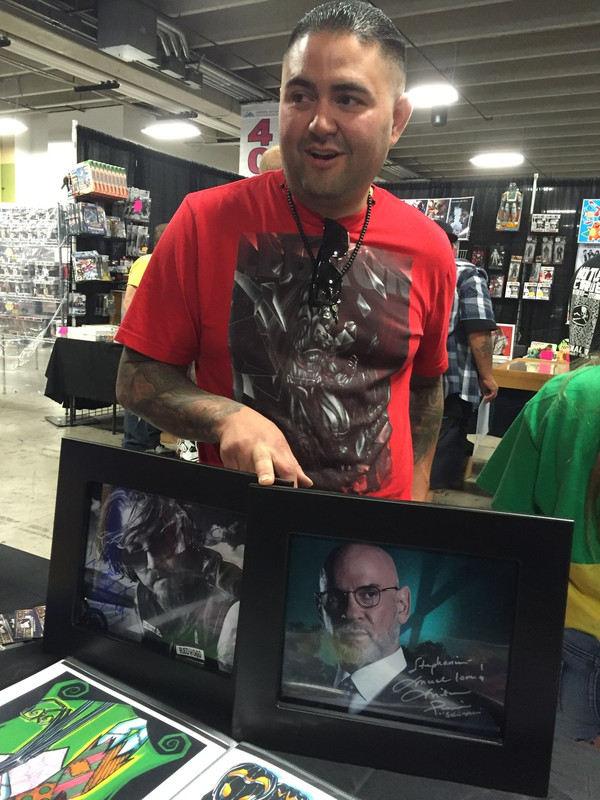 A HAPPY CUSTOMER WITH HIS NEW 8X10'S SHOWS OFF HIS NEW AUTOGRAPHS!