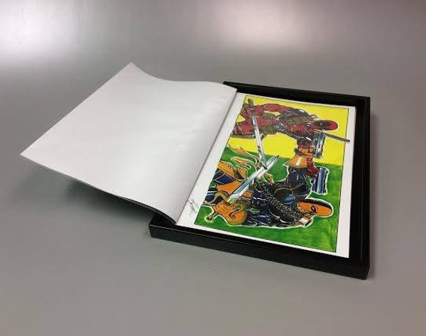 Prints stored in clear page protectors.  Pages can be viewed like a photo album.