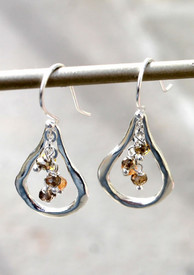 Sterling silver earrings glisten!