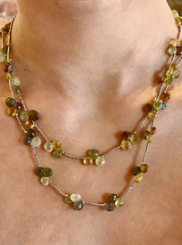 A melange of green garnets and labradorite clusters