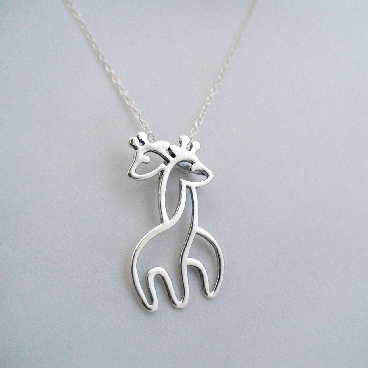 model out on the giraffe shown necklace from chain charm pendant silver crowd sterling stand