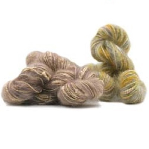 Dune is one of the original yarns from Trendsetter Yarns collection. It is a great workhorse for so many projects. It has a strand of mohair twisted with a subtle metallic yarn.