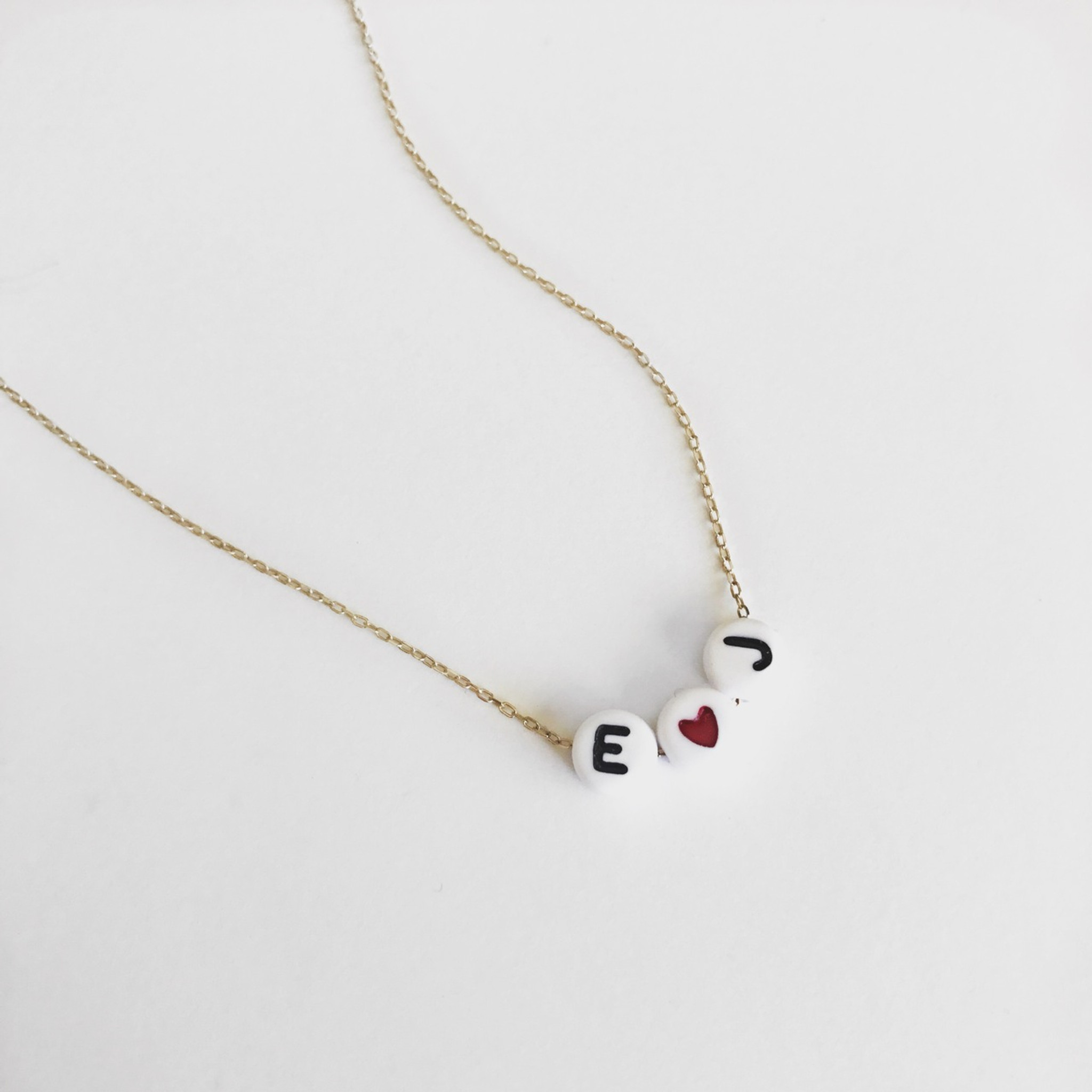varsity moon metal aaea products letter sideways necklace lola and sample
