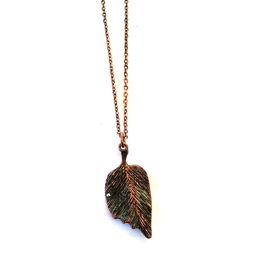 patina leaf necklace and earring set with enameled ladybug