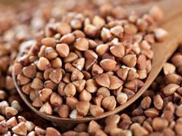 Buckwheat grains on a spoon