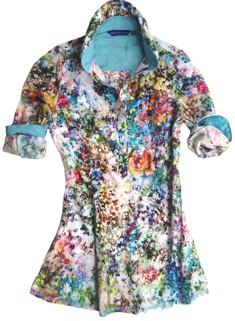Watch your wardrobe bloom with this gorgeous Liberty of London multicolor floral tunic. The soft & lightweight tunic is detailed with an embroidered turquoise contrast inside the collar and cuffs. All seams are done to perfection with contrast stitching in turquoise.
