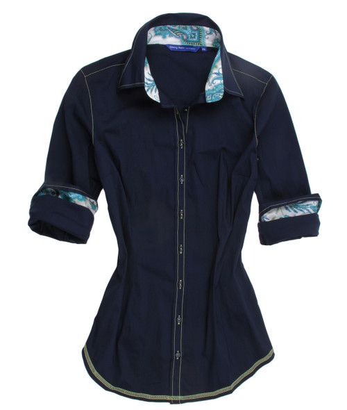 Navy solid stretch with Liberty of London turquoise paisley contrast in collar & cuffs. All seams with contrast stitching in yellow. 69% Cotton 27% Polyamide 4% Elastan