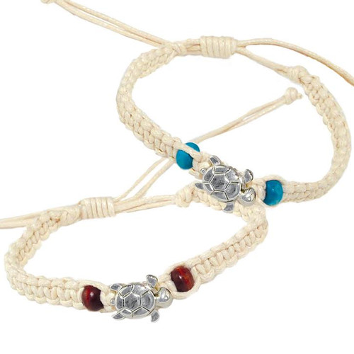 This macrame bracelet features a sea turtle charm and two teal beads. Pair this sea turtle bracelet with our wave ring for a marine inspired look. Not intended for children under 12.