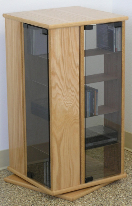 200 DVD Swivel Tower Cabinet With Light Gray Tint Tempered Glass Doors.