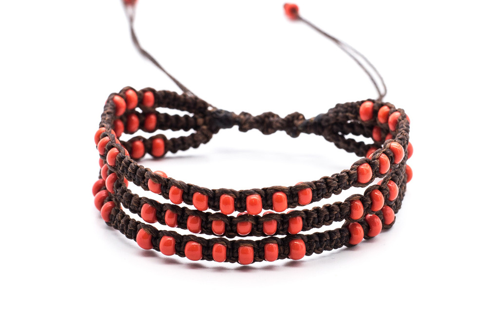 Beautifully handwoven bohemian chic three rows of braided dark brown silk thread bracelet with round seductive red coral fire polished beads. One size, adjustable cord.