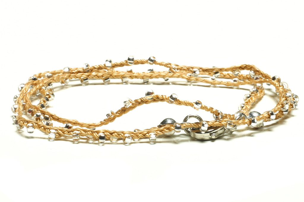 """16"""" braided gold silk thread necklace with clear seed beads and silver plated clasp"""