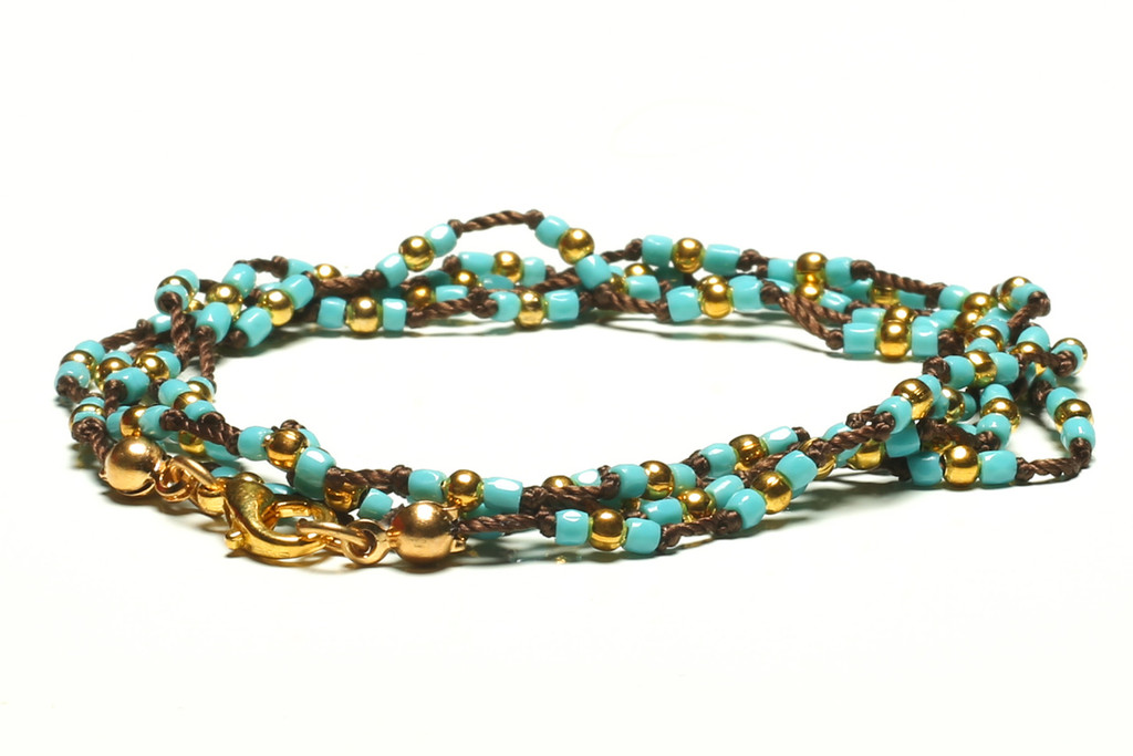 """32"""" braided chestnut brown silk thread necklace with peacock 2-cut hex seed beads, gold plated beads and gold plated clasp"""