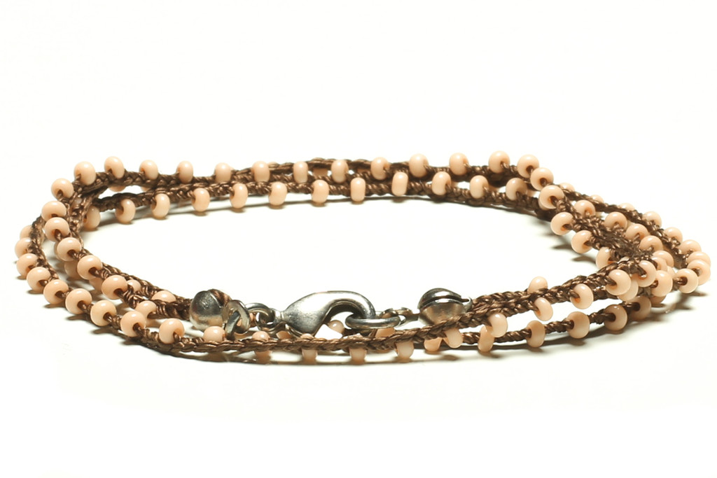 "16"" braided brown silk thread necklace with rose pink seed beads and silver plated clasp."