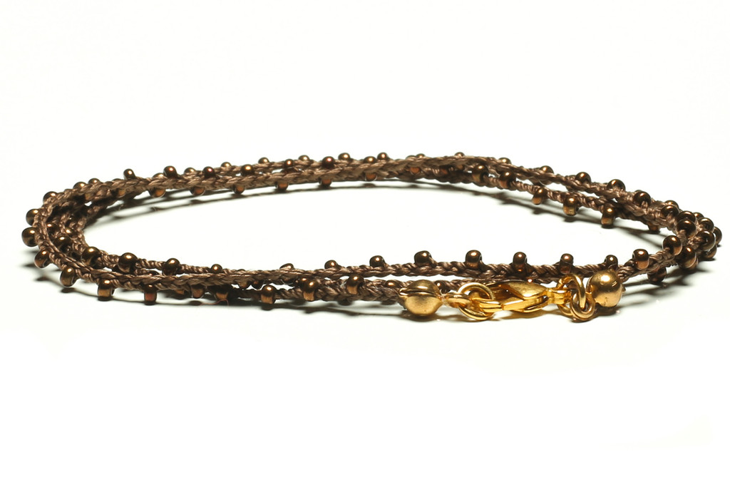 "16"" braided brown silk thread necklace with bronze seed beads and gold plated clasp."