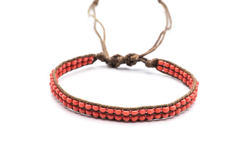 Beautifully handwoven bohemain chic braided natural brown silk thread bracelet with red coral fire polished beads. One size, adjustable cord.