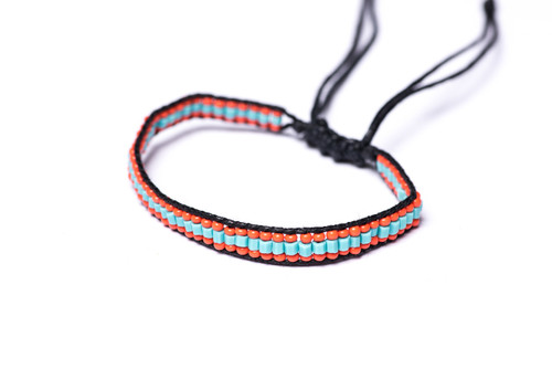 Beautifully handwoven bohemain chic braided black silk thread bracelet with fiery coral seed beads and turquoise bugle beads. One size, adjustable cord.