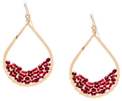 Golden Age hammered tear drop shaped hoop earrings w.garnet fire polished crystals embedded on the bottom inner edges. Gold plate finish. Surgical steel ear wire.