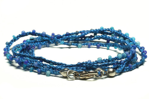 "32"" braided blue silk thread necklace with matte blue seed beads and silver plated clasp"