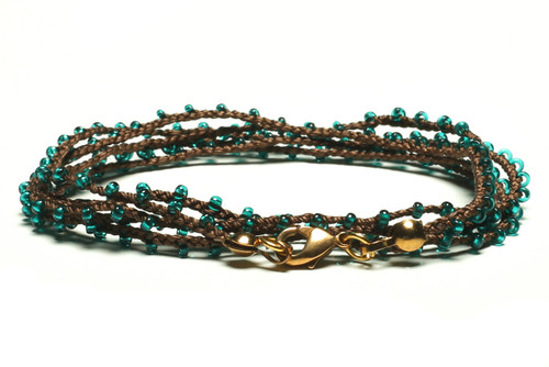 "32"" braided chestnut brown silk thread necklace with transluscent teal seed beads and gold plated clasp"